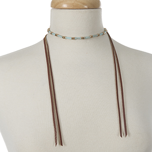 """Gold tone wrap necklace with turquoise beads and brown leather wraps. Approximately 40"""" in length."""