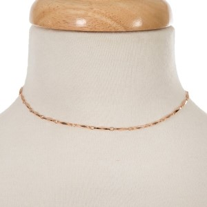 """Rose gold tone choker with connecting oval shapes. Approximately 12"""" in length."""