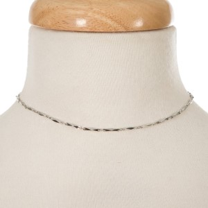 """Silver tone choker with connecting oval shapes. Approximately 12"""" in length."""