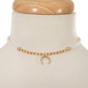 """Ivory and opal beaded choker with a gold tone crescent pendant. Approximately 12"""" in length."""