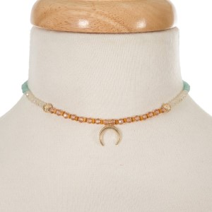 """Ivory, coral and mint green beaded choker with a gold tone crescent pendant. Approximately 12"""" in length."""