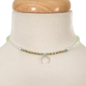 """Mint green and opal beaded choker with a silver tone crescent pendant. Approximately 12"""" in length."""