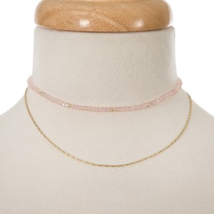"""Pale pink and gold tone layered choker. Approximately 12"""" in length."""
