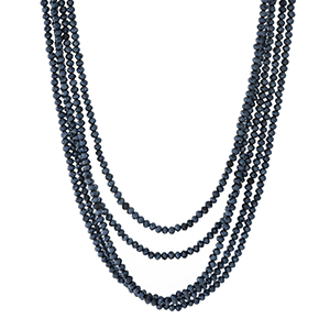 """Gold tone necklace set with multiple rows of navy blue beads. Approximately 16"""" to 18"""" in length."""