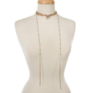 """Peach, champagne, and topaz beaded choker with gold tone chains and tassels. Approximately 12"""" in length."""