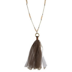 """Burnished gold tone necklace with topaz beads and a fabric tassel pendant. Approximately 32"""" in length."""