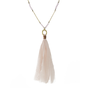 """Burnished gold tone necklace with blush pink beads and a fabric tassel pendant. Approximately 32"""" in length."""