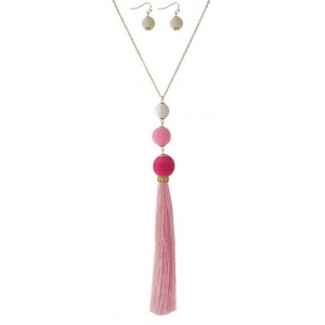 """Gold tone necklace set with pink ombre, thread wrapped beads, a thread tassel and matching fishhook earrings. Approximately 32"""" in length."""