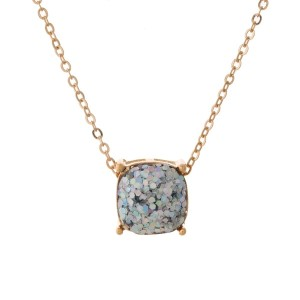 "Gold tone necklace with an iridescent glitter, square pendant. Approximately 16"" in length."