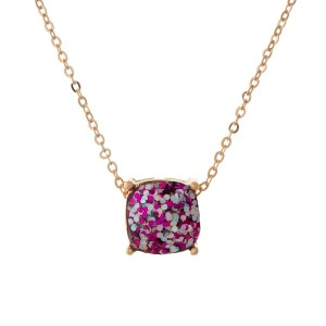 "Gold tone necklace with a fuchsia glitter, square pendant. Approximately 16"" in length."