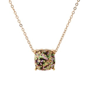 "Gold tone necklace with a pink and green glitter, square pendant. Approximately 16"" in length."