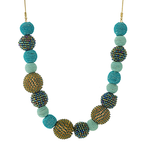 """Silver tone necklace with turquoise thread wrapped ball beads and iridescent beaded accents. Approximately 18"""" in length."""