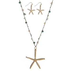 """Brown thread cord necklace with a gold tone starfish pendant and turquoise chipstones along the cord. Approximately 36"""" in length."""