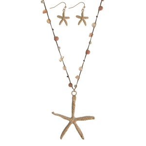 """Brown thread cord necklace with a gold tone starfish pendant and coral chipstones along the cord. Approximately 36"""" in length."""