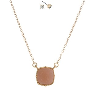 "Gold tone necklace set with a light pink square faux druzy pendant and matching rhinestone stud earrings. Approximately 16"" in length."