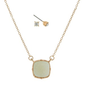 "Gold tone necklace set with a mint green square faux druzy pendant and matching rhinestone stud earrings. Approximately 16"" in length."
