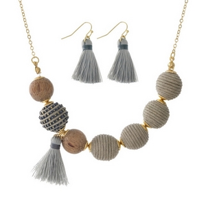 """Gold tone necklace set with gray thread wrapped beads and wooden bead and tassel accents. Approximately 16"""" in length."""