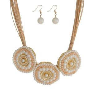 """Tan cord statement necklace with three pale pink and pearl beaded circles and matching fishhook earrings. Approximately 16"""" in length."""