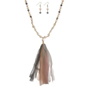 """Pale pink, ivory, and gray beaded necklace set with a fabric tassel, freshwater pearl beads, and matching fishhook earrings. Approximately 32"""" in length."""