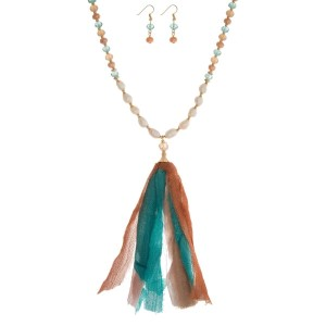 """Peach and mint green beaded necklace set with a fabric tassel, freshwater pearl beads, and matching fishhook earrings. Approximately 32"""" in length."""