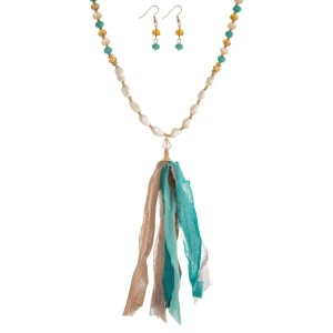 """Topaz, brown and mint green beaded necklace set with a fabric tassel, freshwater pearl beads, and matching fishhook earrings. Approximately 32"""" in length."""
