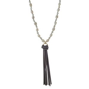 """Gray faux suede necklace with freshwater pearl beads and a tassel pendant. Adjustable up to 36"""" in length."""