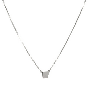 "Dainty silver tone necklace with a state of Arkansas pendant. Approximately 16"" in length."