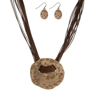 """Brown cord necklace set with a hammered gold tone circle pendant and matching fishhook earrings. Approximately 16"""" in length."""