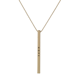 "Dainty gold tone necklace with a bar pendant, stamped with ""Hope."""