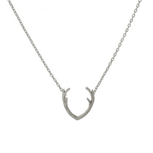 """Dainty silver tone necklace with an antler pendant. Approximately 16"""" in length."""