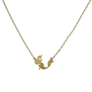"Dainty gold tone necklace with a mermaid pendant. Approximately 16"" in length."
