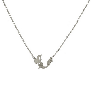 "Dainty silver tone necklace with a mermaid pendant. Approximately 16"" in length."