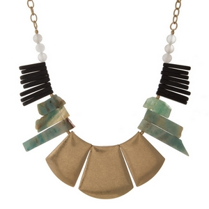 "Gold tone statement necklace with mint green and black natural stone pieces. Approximately 16"" in length."