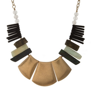 "Gold tone statement necklace with green and black natural stone pieces. Approximately 16"" in length."