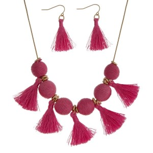 "Gold tone necklace set with pink thread wrapped balls and tassel accents. Approximately 16"" in length."