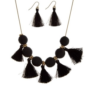 """Gold tone necklace set with black thread wrapped balls and tassel accents. Approximately 16"""" in length."""