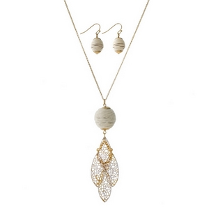 """Gold tone necklace set with an ivory thread wrapped ball pendant, a layered filigree pendant and matching fishhook earrings. Approximately 30"""" in length."""