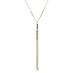 """Gold tone necklace with an ivory beaded tassel and thread wrapped accent. Approximately 32"""" in length."""