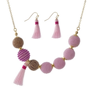 """Gold tone necklace set with pink thread wrapped beads and wooden bead and tassel accents. Approximately 16"""" in length."""