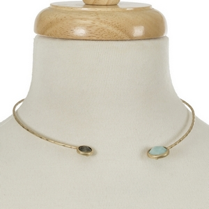 """Gold tone open choker with a mint green and a labradorite stone. Approximately 5.5"""" in diameter."""