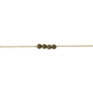 """Gold tone necklace with a gold druzy natural stone bar pendant. Approximately 13"""" in length."""