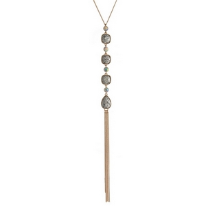 "Gold tone necklace with four iridescent glitter stones and a chain tassel. Approximately 22"" in length."