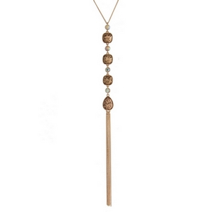 """Gold tone necklace with four topaz glitter stones and a chain tassel. Approximately 22"""" in length."""