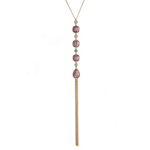 "Gold tone necklace with four light pink glitter stones and a chain tassel. Approximately 22"" in length."