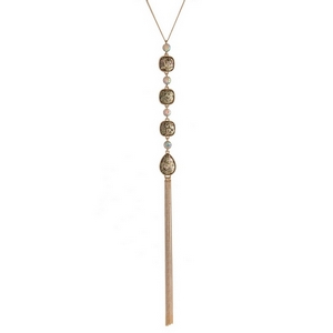 """Gold tone necklace with four olive green glitter stones and a chain tassel. Approximately 22"""" in length."""