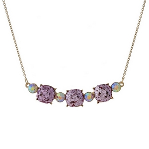 """Gold tone necklace with three light pink glitter squares. Approximately 16"""" in length."""