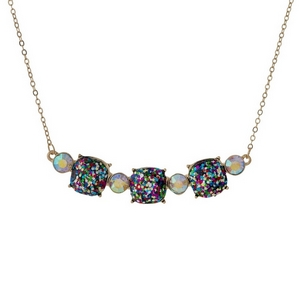 """Gold tone necklace with three multicolored glitter squares. Approximately 16"""" in length."""