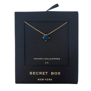 "Secret Box 14 karat gold dipped over brass necklace with a navy blue rhinestone pendant. Approximately 16"" in length."