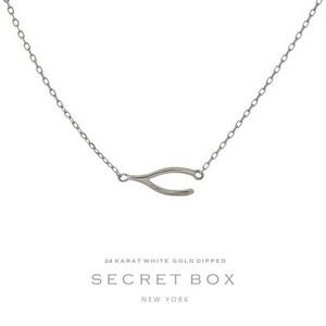 Secret Box 24 Karat White Gold over brass wishbone pendant necklace. 16in length.