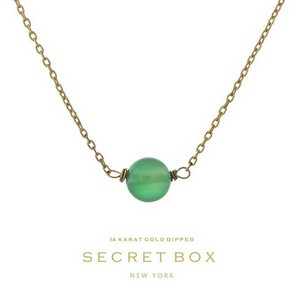 "Secret Box 14 karat gold dipped over brass necklace with a green bead pendant. Approximately 16"" in length."